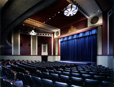 The Rafael Theatre inside. The film center says of itself: This beautifully restored, state-of-the-art, three-screen theater is one of few nonprofit theaters in the United States. The venue exhibits independent documentaries, classics, retrospectives, features, international works and hosts special events with filmmakers from around the world year-round. The Film Center annually serves approximately 150,000 attendees.